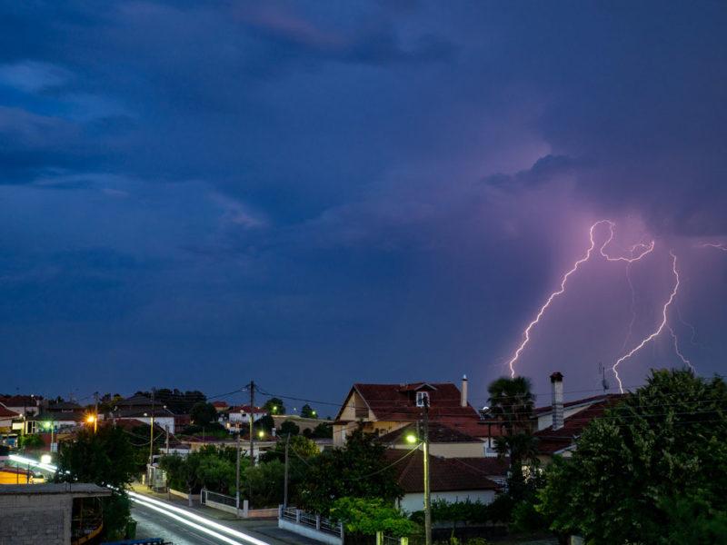 Lightning strike with blue, purple sky.