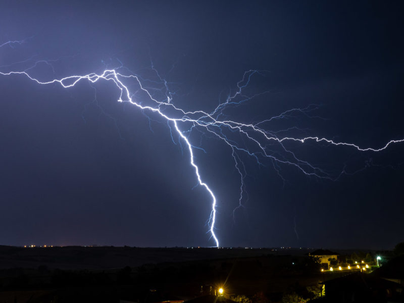 A gigantic lightning strikes at sea.